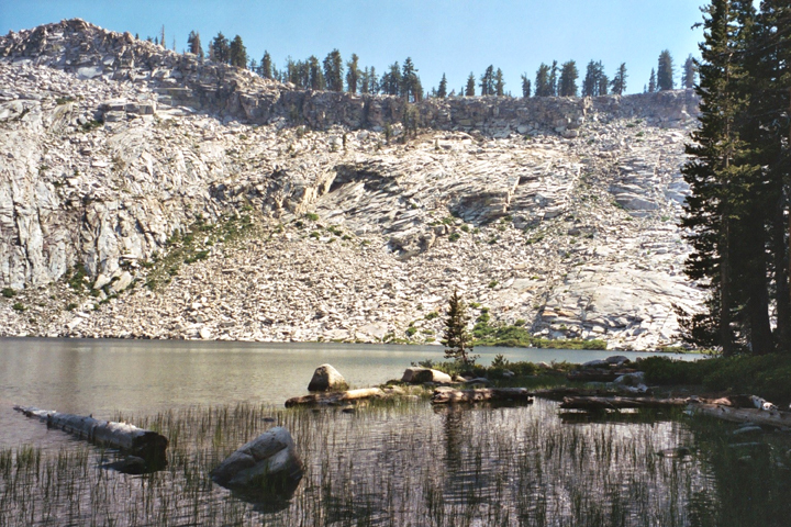 A barren ridge looks over a small lake in the Jennie Lakes Wilderness.